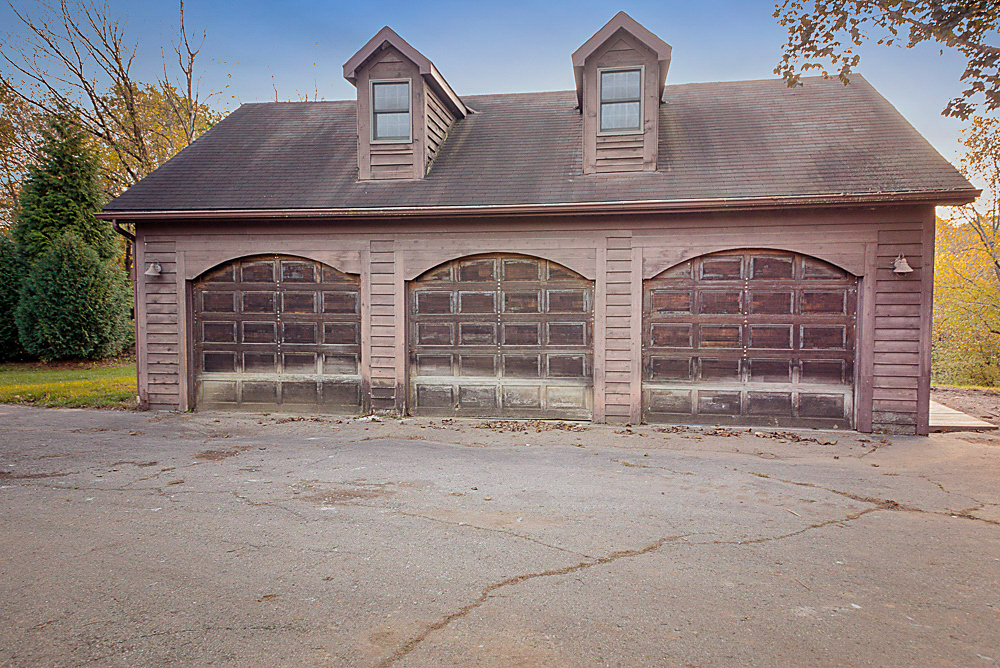 Seller saved the HUGE 3 car garage with unfinished 2nd floor. Who couldn't use more garage space? Endless possibilities for a workshop, car collector, etc.
